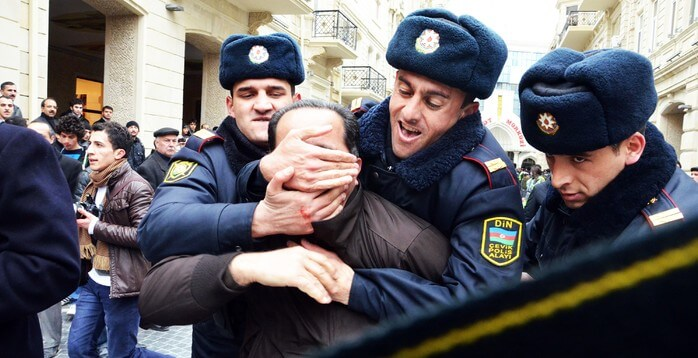 Police officers restrain a protester on the streets of Baku, Azerbaijan. Photo: IRFS