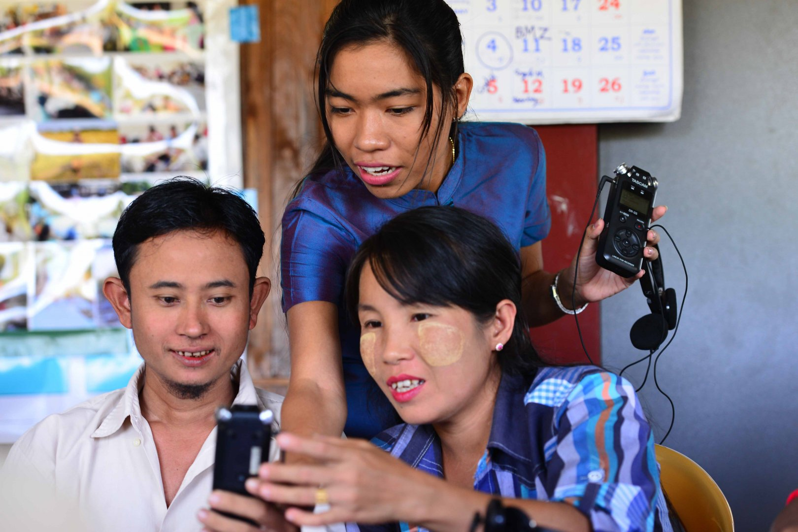 Three participants of a radio workshop in Myanmar