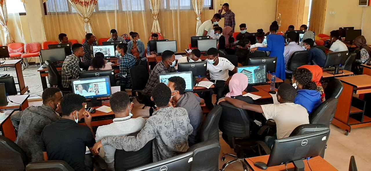 A group of students in Ethiopia gathered togteher in a media literacy class.